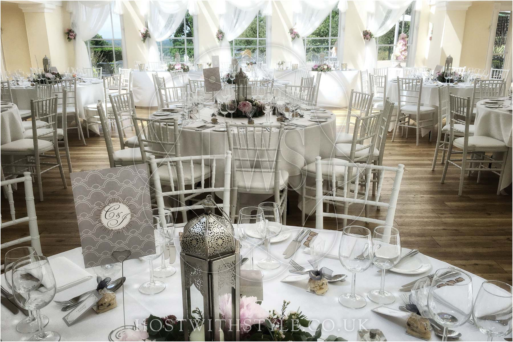 Host with Style chair covers and chiavari chair rental